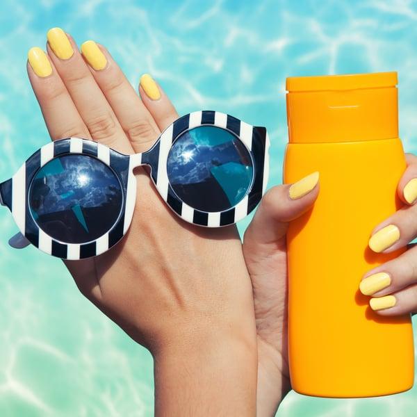 Nails_Yellow_sunglasses_sunscreen_shutterstock_212741572_square