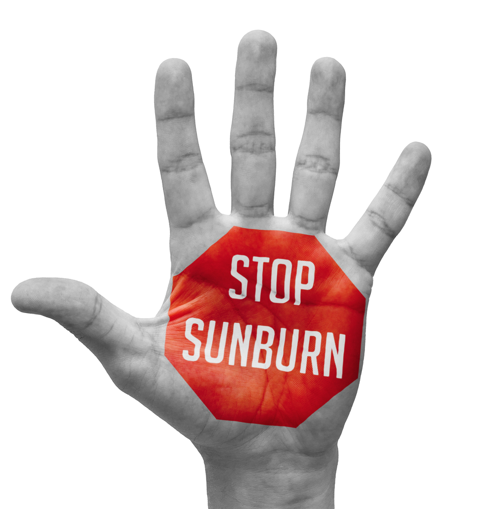 Stop Sunburn Sign Painted - Open Hand Raised, Isolated on White Background.